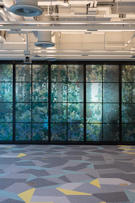 15 - The folding glass wall in the space features a pointillist take on a field of bluebells.jpg